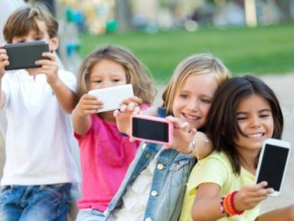Group of childrens taking a selfie in the park.