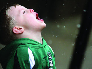 Photo Brittany Randolph/The Star Cameron Rhom, 5, catches snowflakes on his tongue just as snow began to fall in downtown Kings Mountain on Friday.